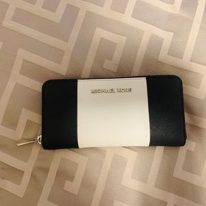 Michael Kors jet set zip around wallet.